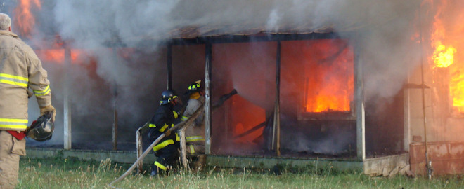 Our firemen practice their skills on a controlled burn.